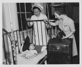 Miss Hart and Chinese nurse visit children's ward in hospital in China