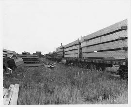 UNRRA railway bridge material is loaded from the dockside onto flat cars