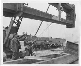 Oliver J Todd, UNRRA Chief Advisory Engineer for the Yellow River Project, supervises the loading...