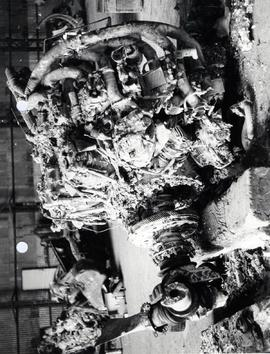 Left hand view of NO. 2 engine showing extent of impact and fire damage.