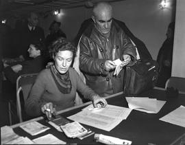 CNRRA / 320 Mrs Thomas Cope of Philadelphia, Pa, of the UNRRA Displaced Persons Division, checkin...