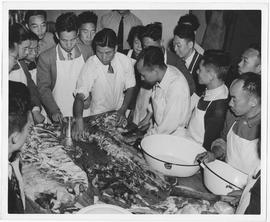Trainees of UNRRA's food preservation training plant in Shanghai practice meat carving and canning during a six-week course conducted by UNRRA instructors from the United States