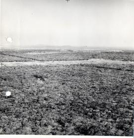 View from direction of approach, Ndola airport in background, crash site in foreground.