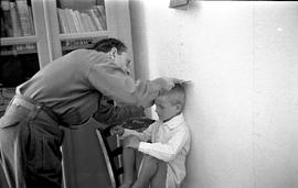 [Greece] A boy is examined during the medical inspection at the Island of Milos by the specially ...