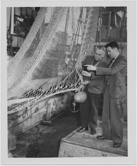[Men examining fishing net, Shanghai, China, July 1947]
