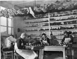 [Germany]: UNRRA /3047 : Hohenfels, Germany, Poles at the UNRRA assembly center at Hohenfels occupy themselves in repairing shoes for the 4000 displaced persons.  They are shorth of leather, but manage to keep busy on what they can find.