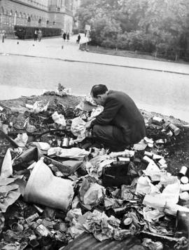 [Austria] One of the many hungry people rummaging amongst the garbage in search of something to eat, May 1946.