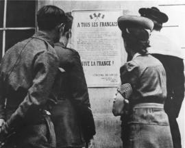 young French men and women reading the poster where all Frenchmen are called upon to continue the...